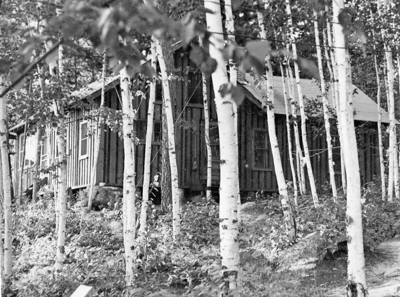 Resort cabin exterior, black and white.